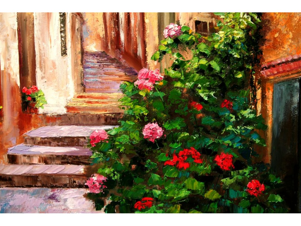 Geraniums In Liguria Italian village alley with flowers